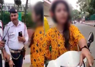 VIDEO : गाडी चालवताना फोनवर बोलल्यामुळे पोलिसांनी थांबवलं, तरुणीचा रस्त्यावरच राडा