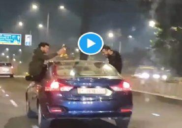 भरधाव गाडीच्या खिडकीत लटकून मद्यपान, मुंबईत तीन स्टंटबाजांना बेड्या